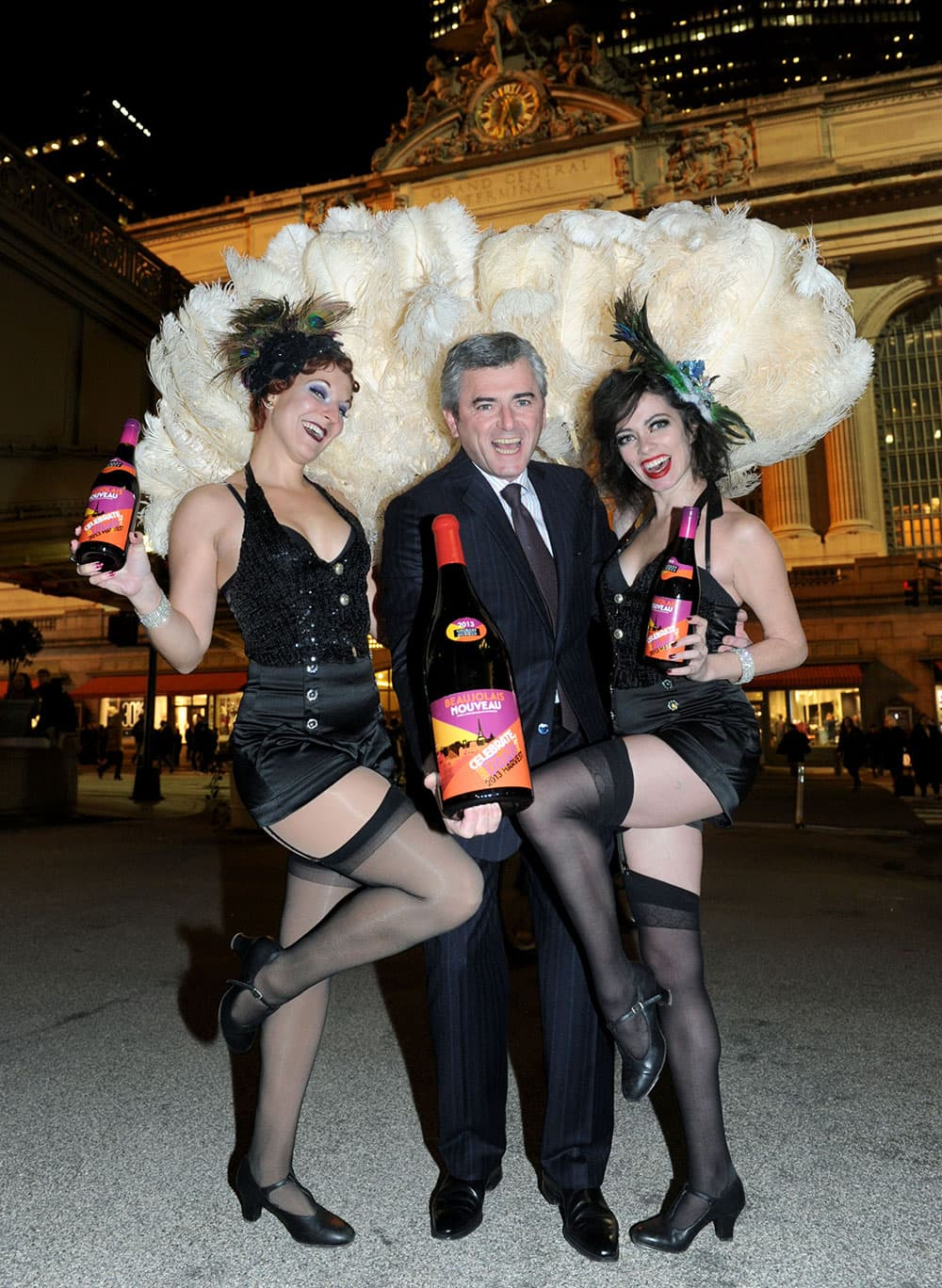 Franck Duboeuf, joined by Jazz Age dancers, unveils the first bottle of the 2013 Georges Duboeuf Beaujolais Nouveau in the US, outside Grand Central Terminal in New York.