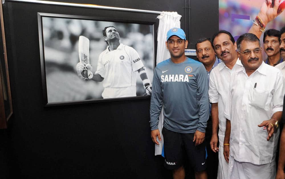 Mahendra Singh Dhoni visits the Sachin Tendulkar pavillion after its inauguration in Kochi.