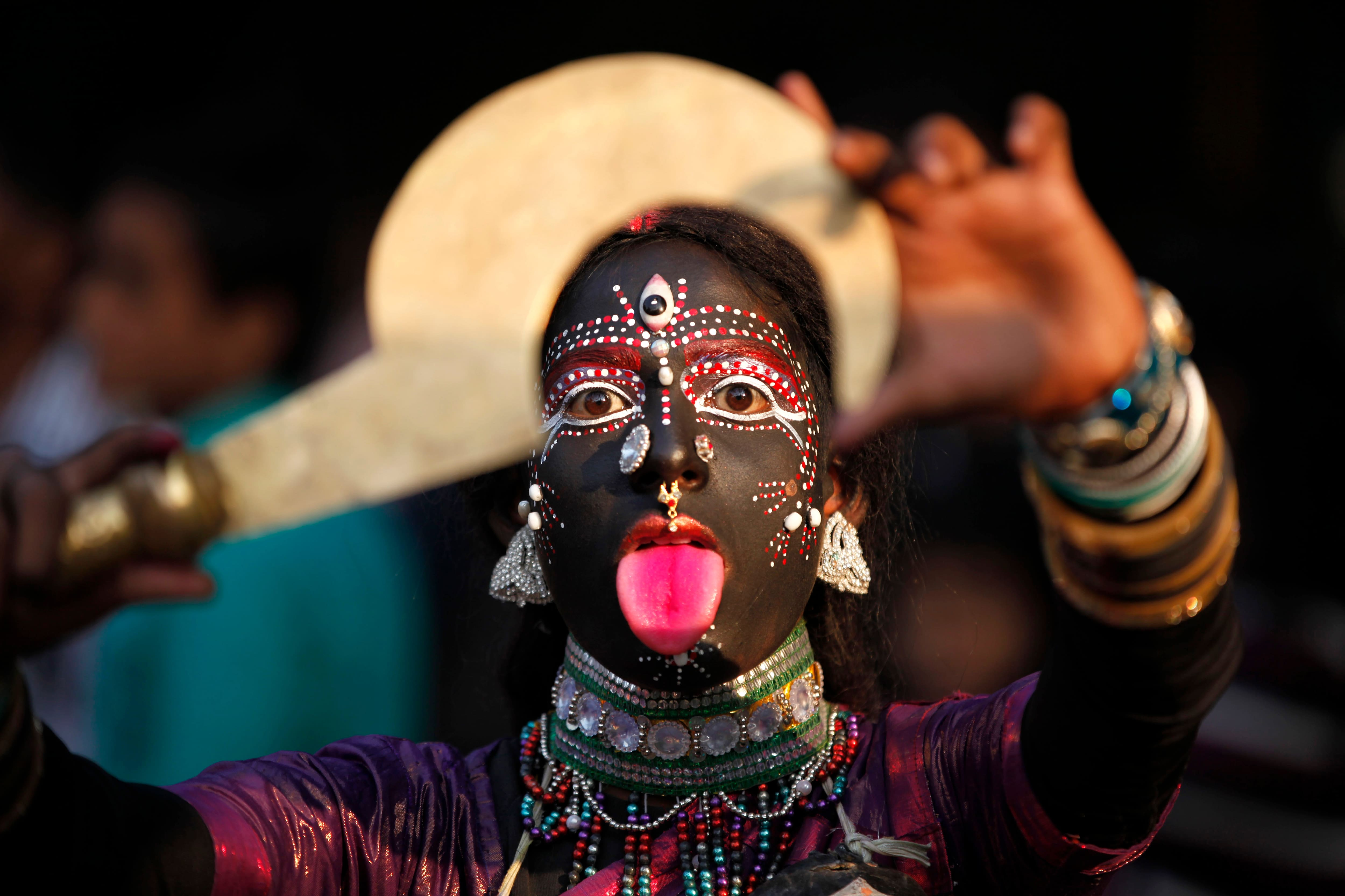 A folk artist from India's northern Uttar Pradesh state performs during a procession held as part of the ongoing all India multilingual short play, folk dance competition and theatre seminar in Allahabad.