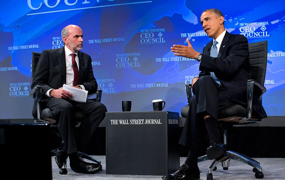 President Barack Obama gestures as he answers a question from Wall Street Journal Washington bureau chief Gerald Seib during the Wall Street Journal CEO Council annual meeting in Washington.