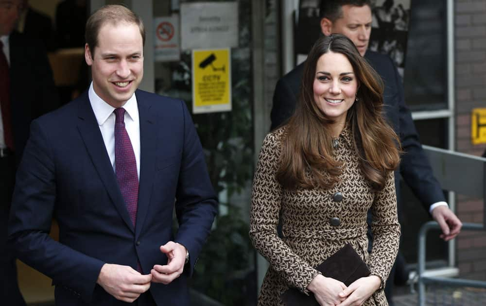 Britain`s Prince William and Kate Duchess of Cambridge leave after their visit at the Only Connect organization head office in London.