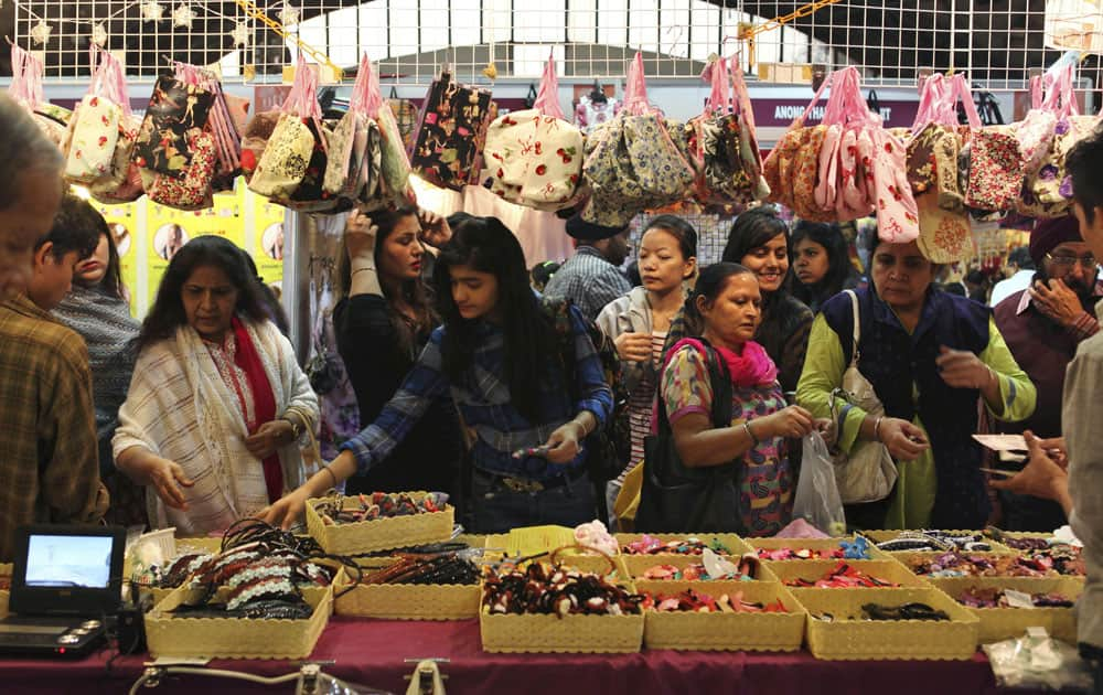 Indian visitors check out hair bands at a Thailand stall during the India International Trade Fair (IITF) in New Delhi.