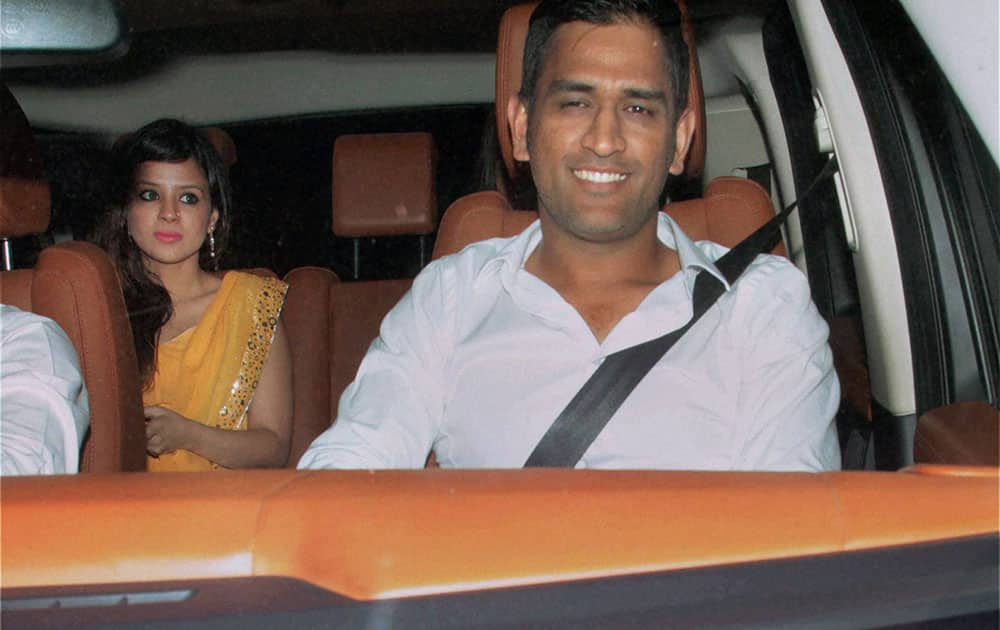 India captain MS Dhoni with wife Sakshi arrive for the farewell party hosted by Sachin and Anjali Tendulkar in Mumbai.