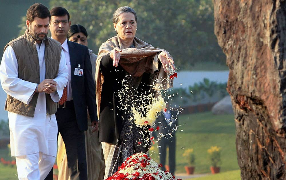 Congress party President Sonia Gandhi, right, pays floral tribute at the memorial of her mother-in-law and former Prime Minister Indira Gandhi, on her birth anniversary in New Delhi.
