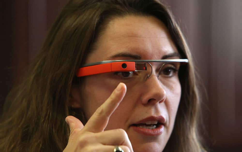 Dr. Heather Evans points to the new Google Glass device at Harborview Medical Center, in Seattle, Wash.