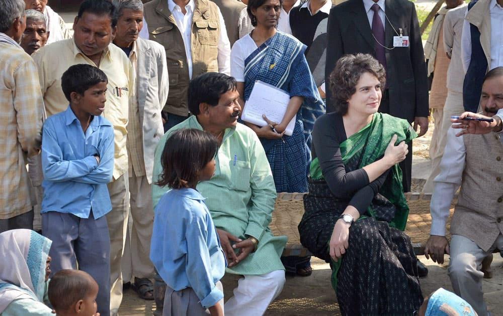 Priyanka Vadra listening to the problems of villagers at Rampur Khas in Raebareli.