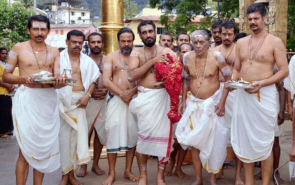 Chief priest PN Narayanan Namboothiri and Thantri Kandararu Maheswararu preparing for 'Kalababhishekam' at Lord Ayyappa temple in Sabarimala.