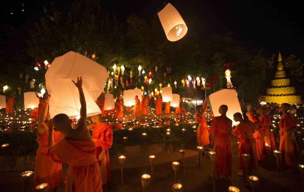 Buddhist monks prepare to release sky lantern after a blessing ceremony during the Loy Krathong Festival at a temple in Chiang Mai, Thailand. Buddhist monks prepare to release sky lantern after a blessing ceremony during the Loy Krathong Festival at a temple in Chiang Mai, Thailand.