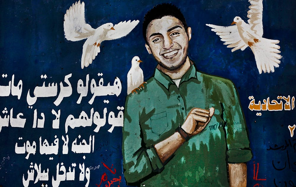 A mural depicting Egyptian activist, Mohammed Hussein, who died during anti-government protests in 2013 is painted on a wall in Tahrir Square, Cairo, Egypt.