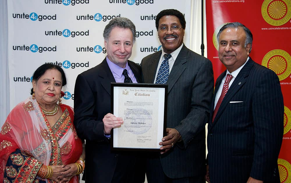 Unite4:good founder Anthony Melikhov, center, receives New York State Assembly Citation from New York State Assemblyman William Scarborough, right, flanked by Uma Sengupta, District Leader Queens, left, and Roger Sengupta at the Unite4:good New York City launch event to promote revolutionary movement for humanity,  in the Flushing section of the Queens borough of New York.
