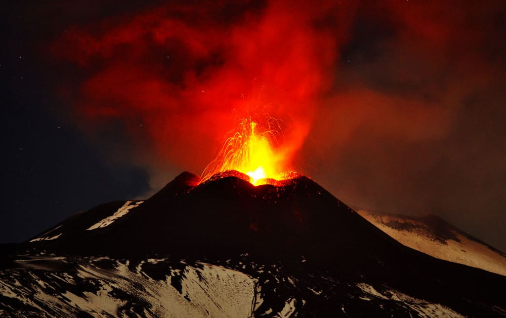Mt. Etna, Europe`s most active volcano, spews lava during an eruption as seen from Acireale, near the Sicilian town of Catania, Italy.