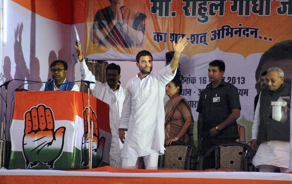 Congress Vice President Rahul Gandhi waves during a rally in Raipur.