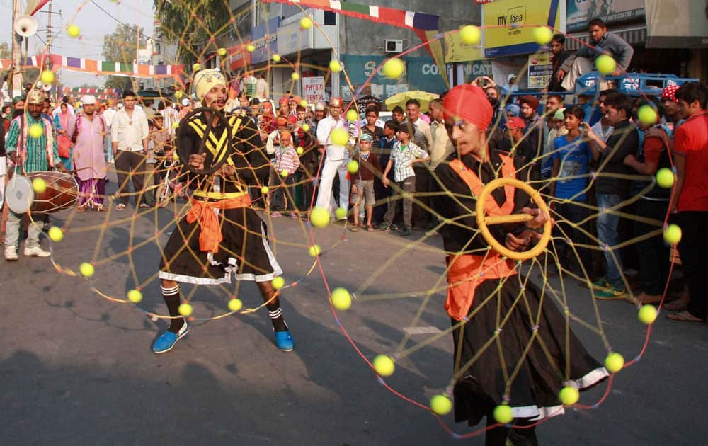 Sikhs show their skills during a procession on 545th birth anniversary of Guru Nanak Dev ji in Gurgaon.