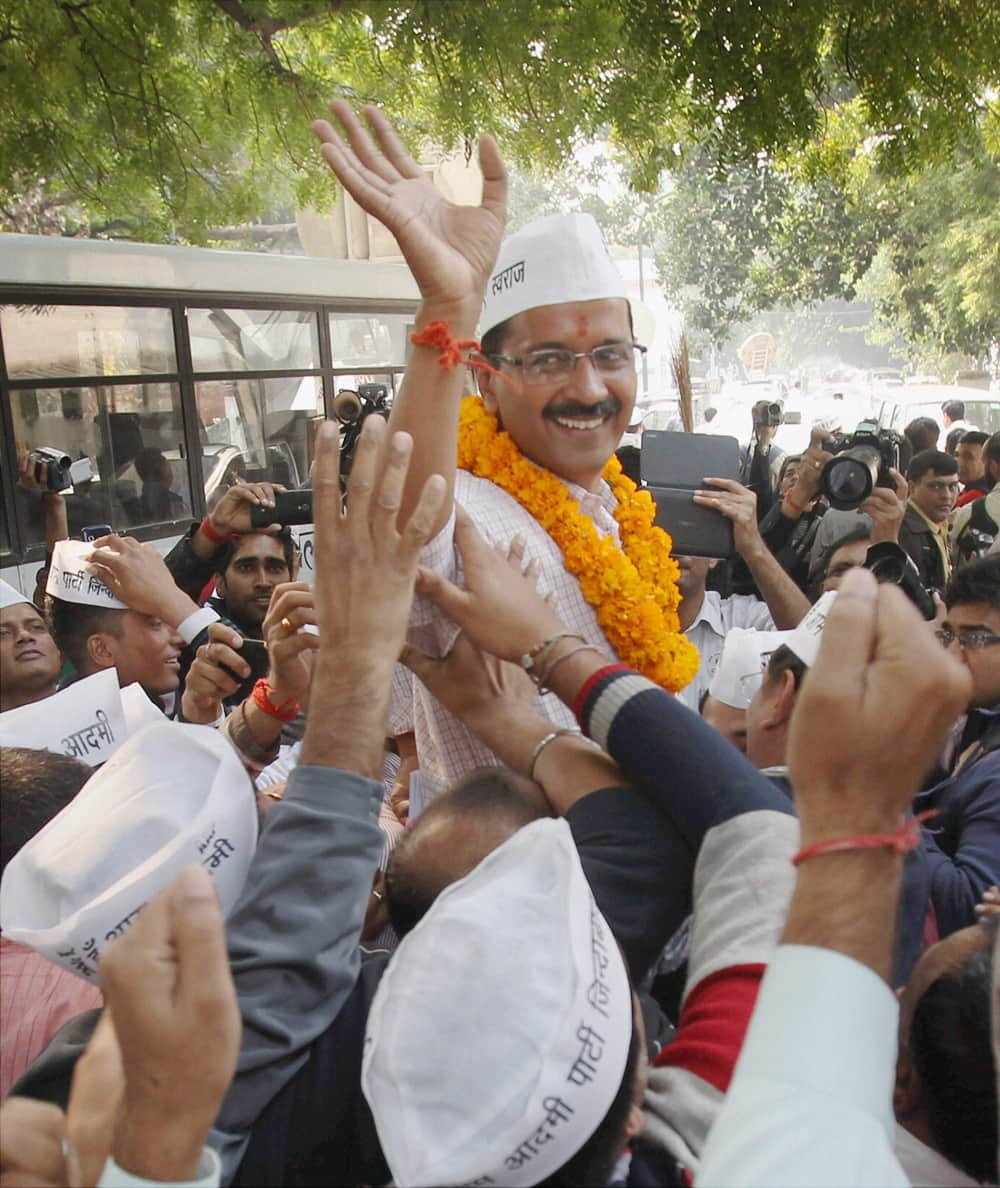 AAP convener Arvind Kejriwal wave to the supporters after filing his nomination papers from the New Delhi constituency at Jamnagar House in New Delhi.