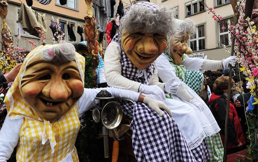 Masked revellers celebrate the start of the carnival season on the Hirschenplatz square in Zurich, Switzerland.