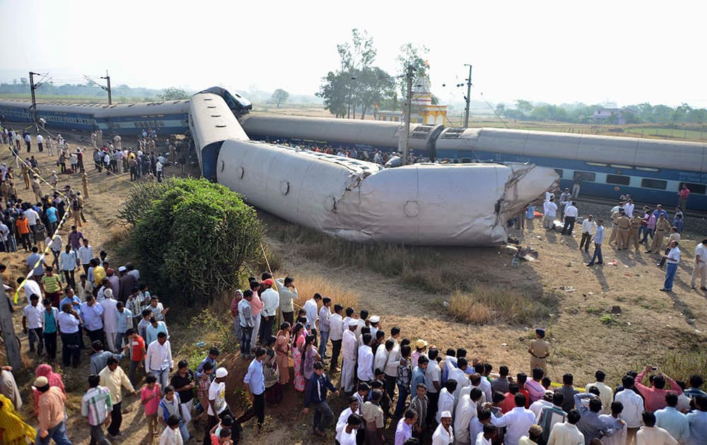People gather at the site of a train accident near Nashik, 165 kilometers (100 miles) north of Mumbai.