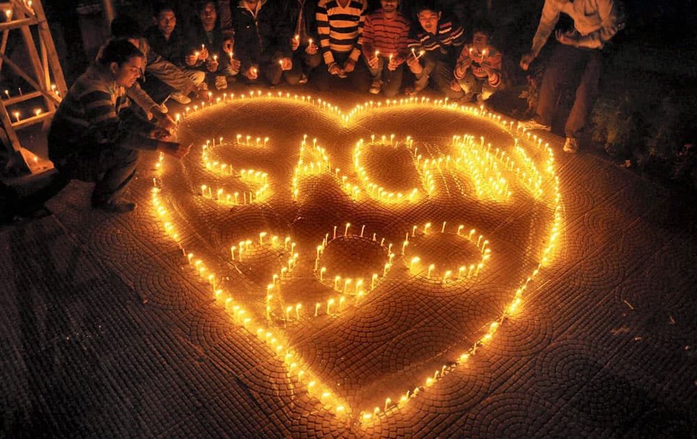 People light candles that read Sachin Tendulkar 200 on the eve of his last 200th test match in Moradabad.