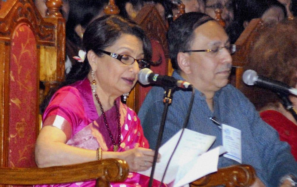 Veteran Bollywood actress Sharmila Tagore recites as Sugata Bose (R), grand nephew of Netaji Subhash Chandra Bose, looks on during a function to celebrate centenary of Tagore`s Nobel Prize in India.