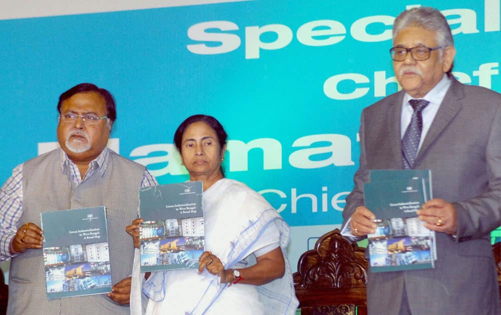 West Bengal Chief Minister Mamata Banerjee Mamata Banerjee launching CII Biz Bridge Directory with State Commerce & Industry Minister Partha Chatterjee and Sumit Mazumdar (R), Vice President, Confederation of Indian Industry at the Special Plenary session during `4th Biz Bridge`, an engineering & manufacturing exhibition and conference, in Kolkata.