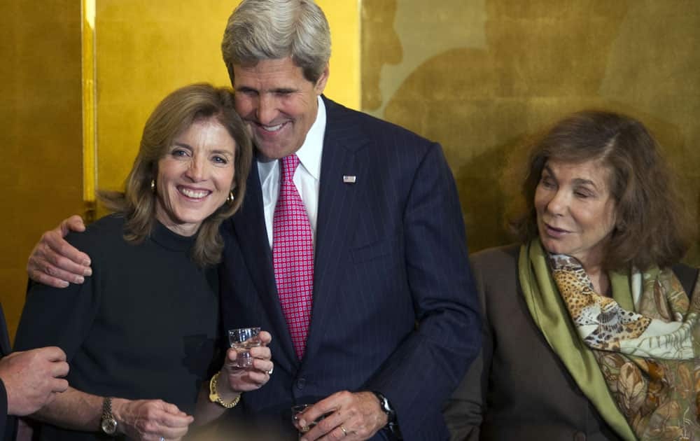 Secretary of State John Kerry hugs U.S. Ambassador to Japan Caroline Kennedy, as his wife Teresa Heinz Kerry, right, watches during a reception at the Japanese Ambassador`s residence in Washington.
