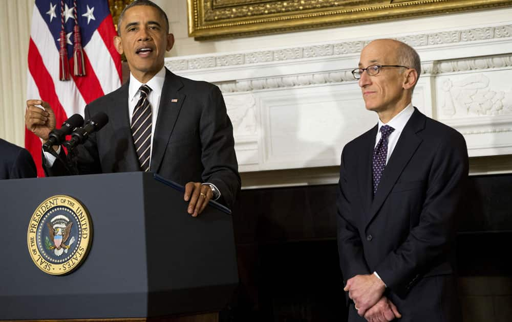 President Barack Obama announces that he will nominate Timothy Massad, right, to become chairman of the Commodity Futures Trading Commission (CFTC), in the State Dining Room of the White House in Washington.