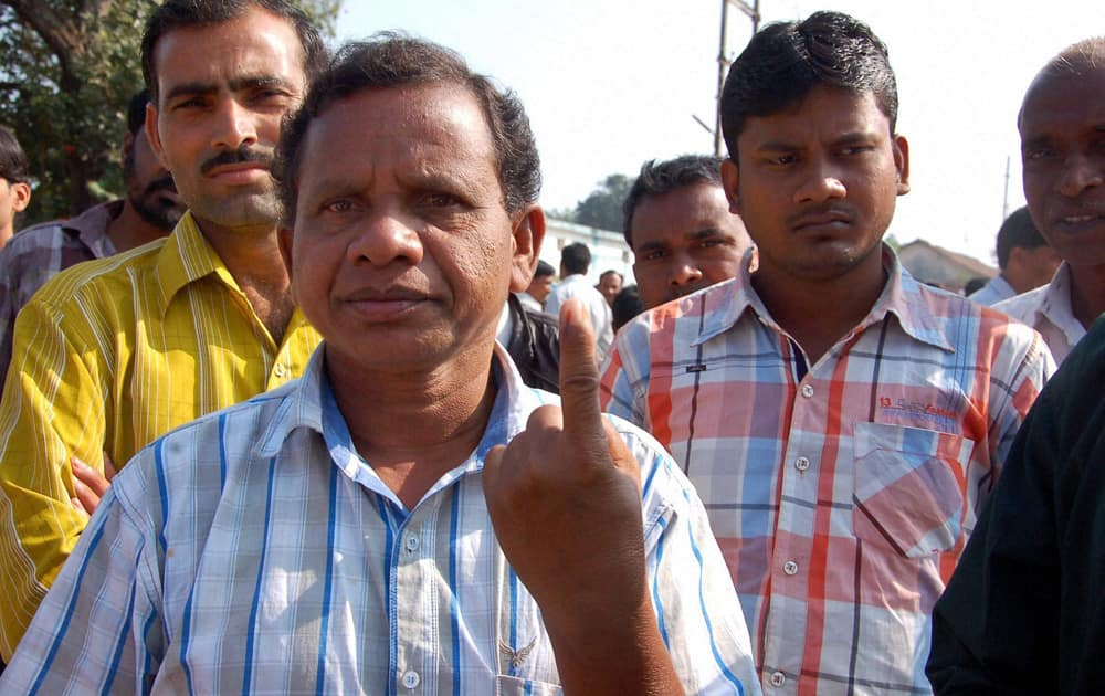 A voter shows his finger marked with indelible ink after casting his vote at a polling station in Dantewada during the first phase of polling for Chhattisgarh Assembly elections.