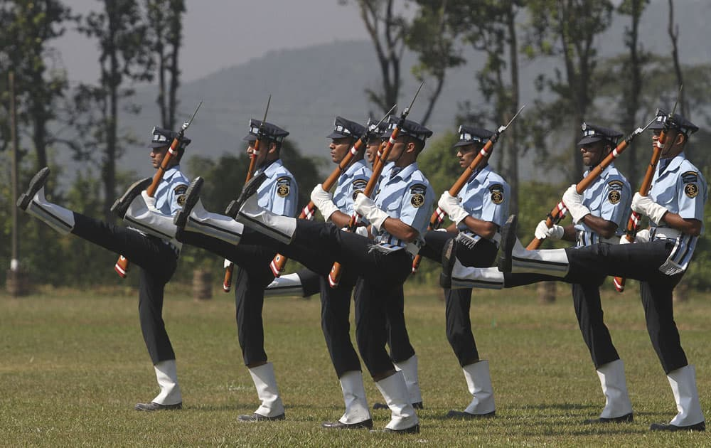 Indian Air force personnel perform a drill during raising day celebrations of the Sainik School at Goalpara, Assam state.