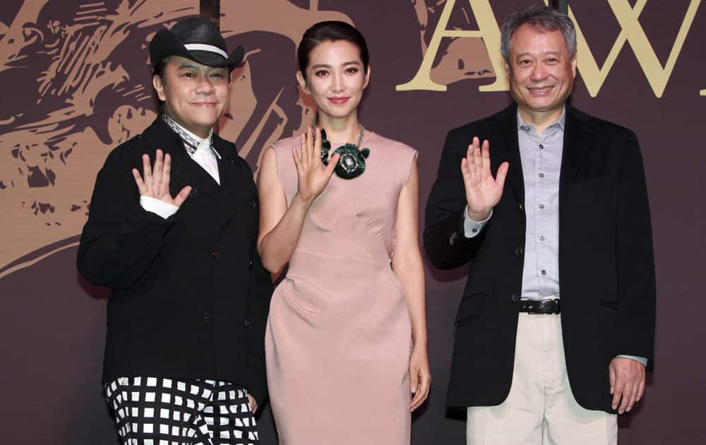 Taiwanese director Ang Lee, right, Chinese actress Li Bing Bing, center, and Taiwanese host Kevin Tsai smile during a media event for the 50th Golden Horse Awards in Taipei, Taiwan.