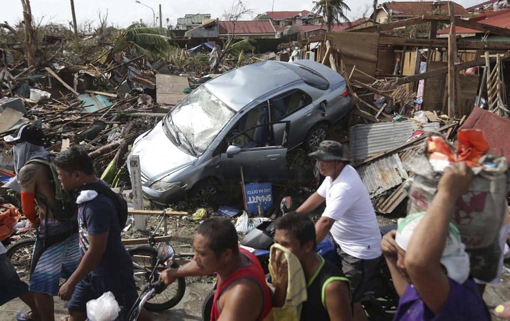 Survivors move past the damage caused by Typhoon Haiyan in Tacloban city, Leyte province, central Philippines.