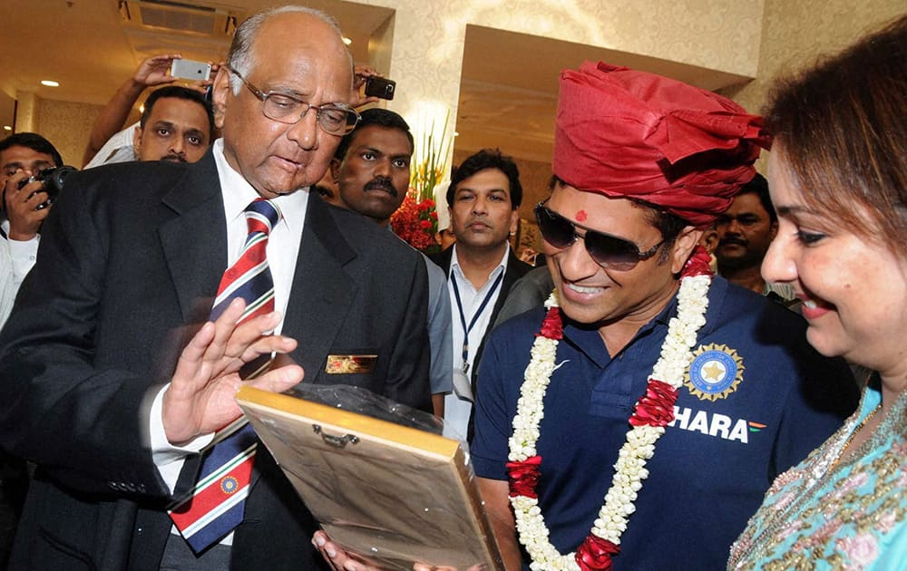 MCA, President Sharad Pawar (L) with Sachin Tendulkar and his wife Anjali (R) during the Mumbai Cricket Association`s Sachin Tendulkar Gymkhana naming function at Kandivali, North Mumbai.