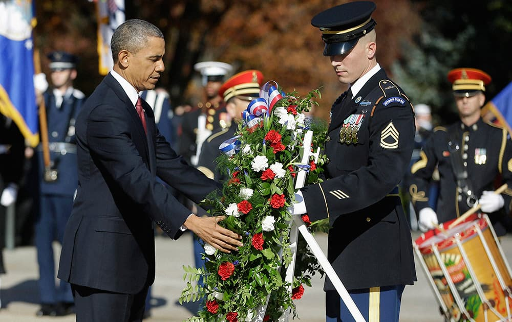 President Barack Obama places a wreath at the Tomb of the Unknowns at Arlington National Cemetery in Arlington, Va., during a Veterans Day ceremony.
