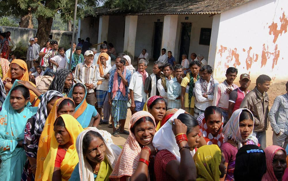 People wait to cast their votes at a polling booth in Dantewada during the first phase of polling for Chhattisgarh Assembly elections.