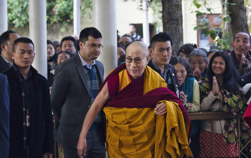 Tibetan spiritual leader the Dalai Lama, arrives at the Tsuglakhang temple to give religious talk for a day in Dharmsala.