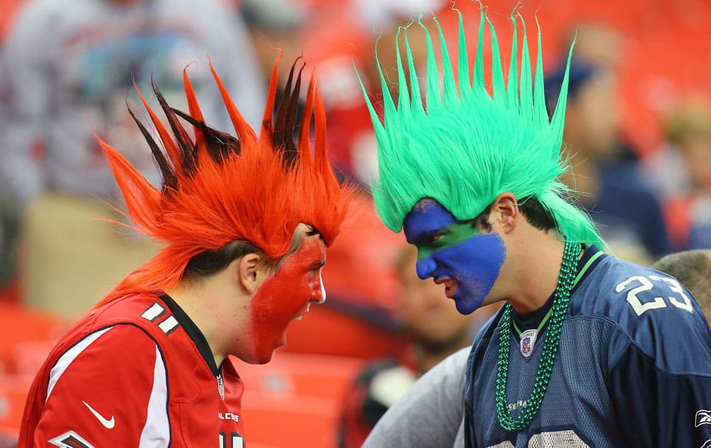 An Atlanta Falcons fan and a Seattle Seahawks fan face-off during the second half of a NFL football game.