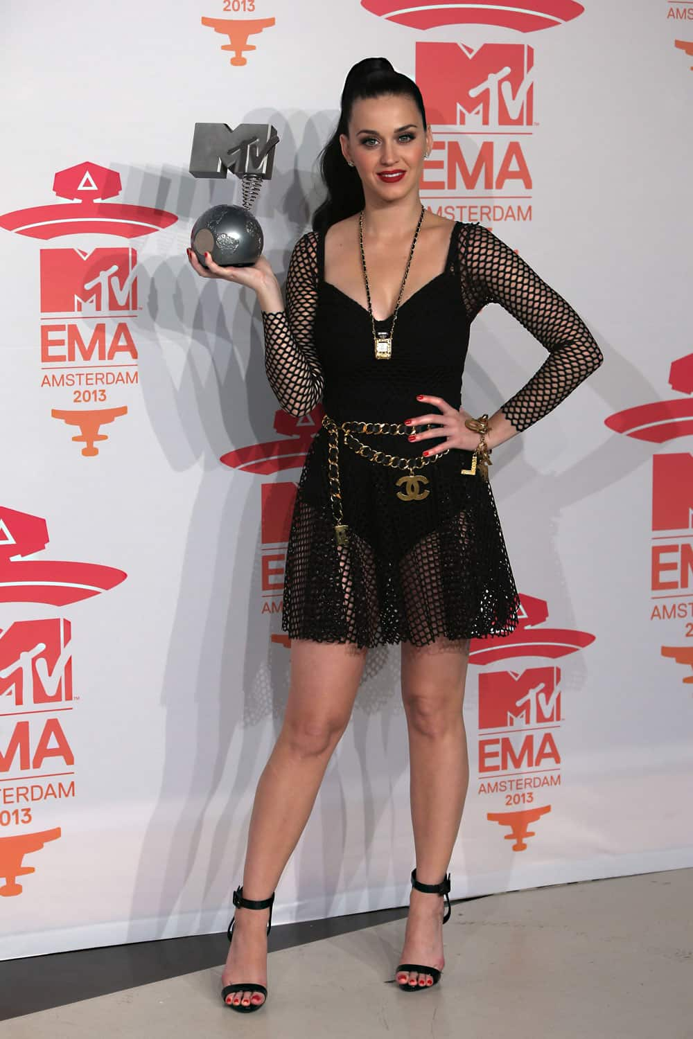 Katy Perry poses for photographers backstage with her award for Best Female at the 2013 MTV Europe Music Awards, in Amsterdam.