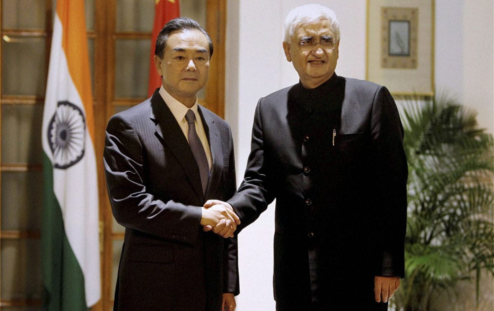 External Affairs Minister Salman Khurshid with his Chinese counterpart Wang Yi before a meeting at Hyderabad house in New Delhi.