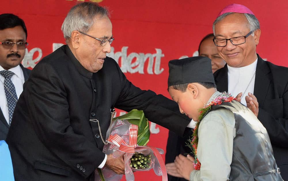 President Pranab Mukherjee being welcomed by a student during the inauguration of 125th Year Jubilee Celebrations of ST Joseph`s School at Darjeeling in West Bengal.