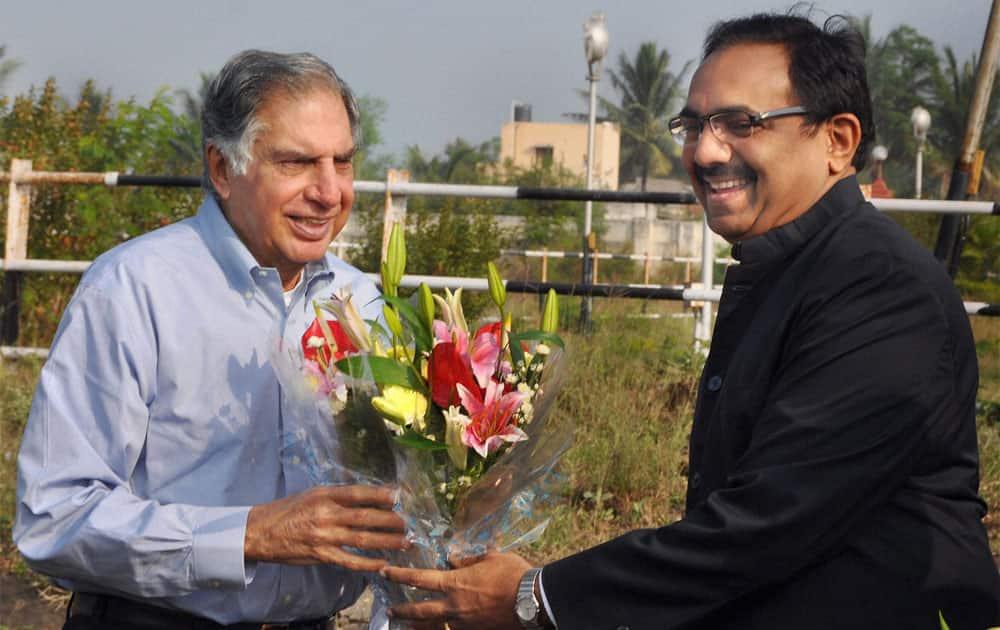 Industrialist Ratan Tata being welcomed by Maharashtra Rural Development Minister Jayant Patil at Karad airport in Maharashtra.