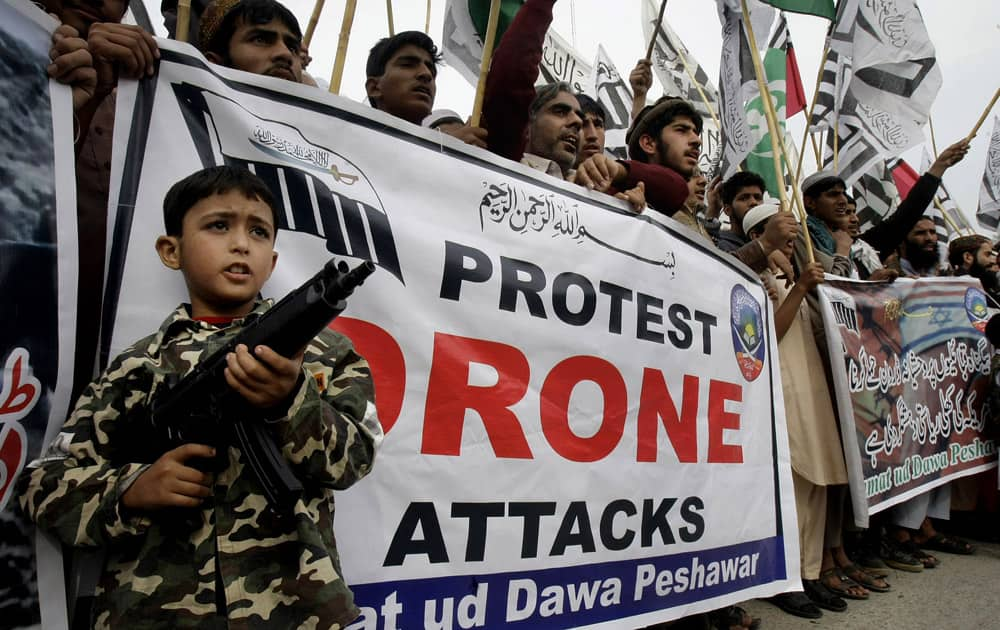 Supporters of a Pakistan religious group, Jamaat-ud-Dawwa, chant slogans during a protest to condemn U.S. drone attacks, in Peshawar.