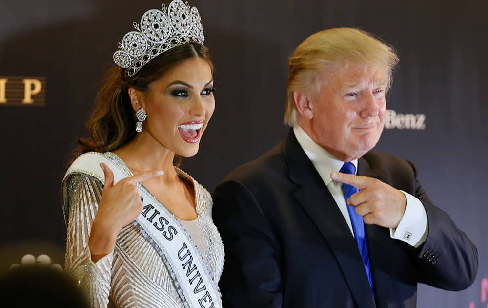 Miss Universe 2013 Gabriela Isler, from Venezuela, left, and pageant owner Donald Trump, of the United States, point to each other while posing for a photo after the 2013 Miss Universe pageant in Moscow, Russia.