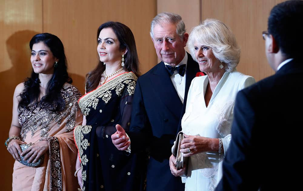 Britain`s Prince Charles and his wife Camilla, the Duchess of Cornwall, stand with Bollywood actress Kajol, left, and businesswoman Nita Ambani, 2nd left, before a dinner to support the work of British Asian Trust in Mumbai.