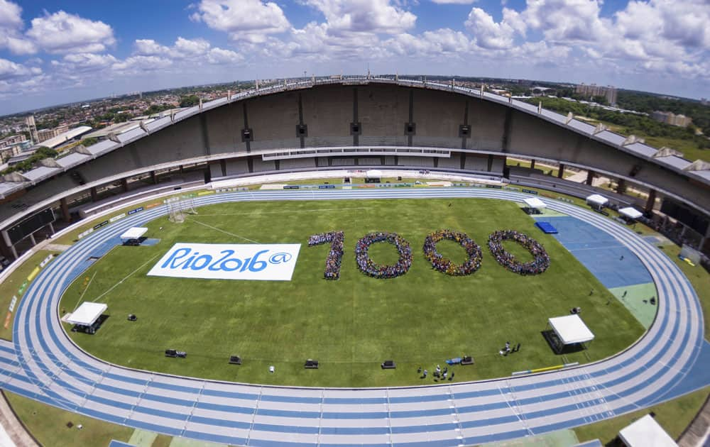 This photo released by Rio 2016 Organizing Committee for the Olympic and Paralympic Games, youths form the number 1,000 to mark the number of days before the start of the Rio 2016 Olympic Games inside Mangueirao stadium in Belem, Brazil.