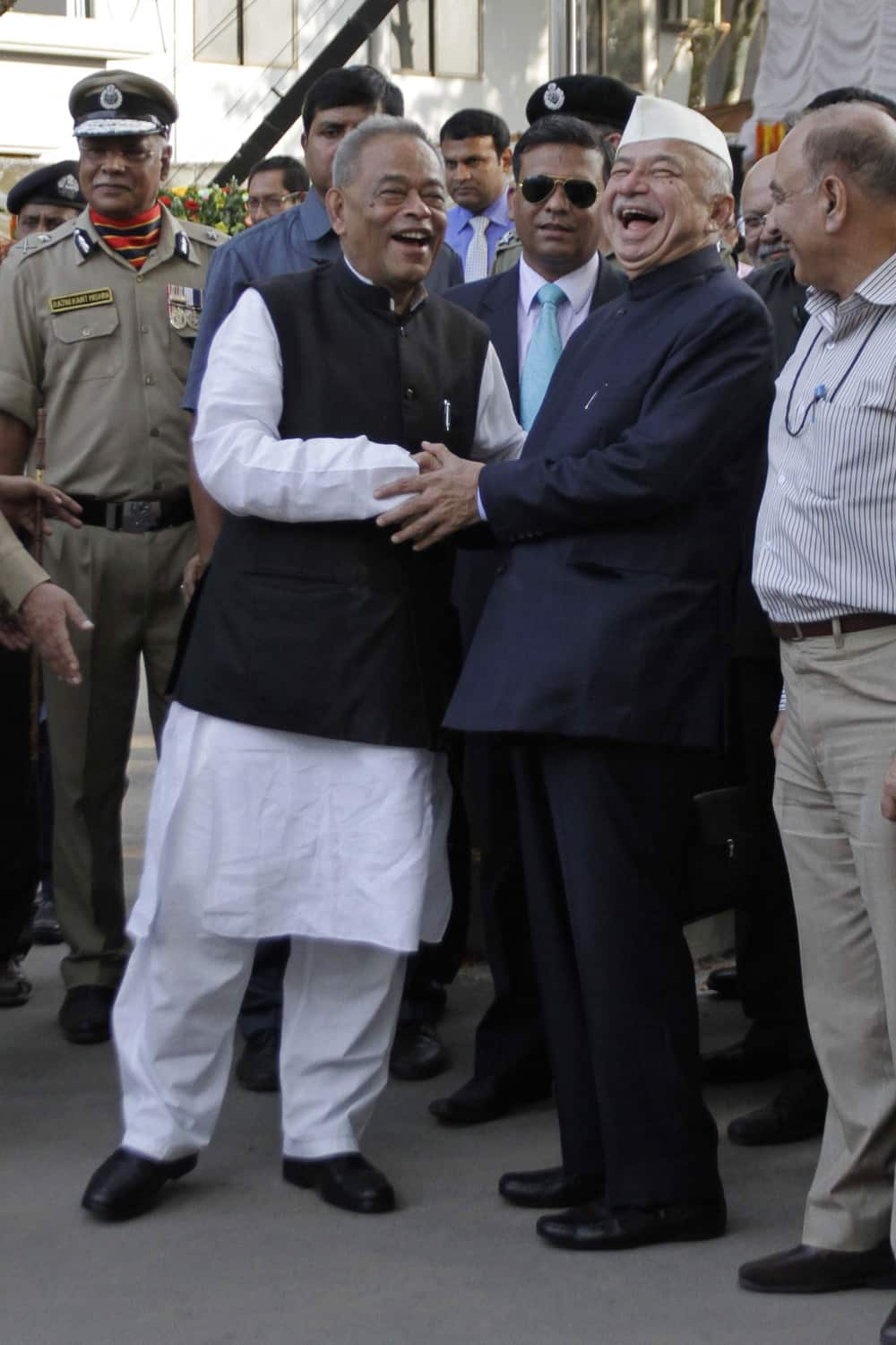 Indian Home Minister Sushilkumar Shinde shares a lighter moment with his Bangladeshi counterpart Muhiuddin Khan Alamgir after the inauguration of the India-Bangladesh joint retreat ceremony in Petrapole, about 100 kilometers (63 miles) east of Kolkata.