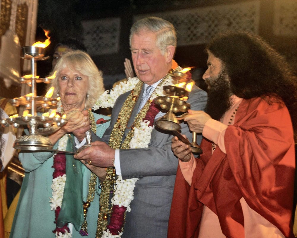 Prince of Wales, Prince Charles and Duchess of Cornwall Camilla with head of Parmarth Niketan Ashram, Swami Chidanand take part in an Aarti ceremony at the Parmarth Niketan Temple on the banks of the River Ganges during first day of their official visit to India, in Rishikesh.