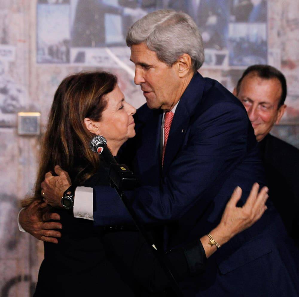 Secretary of State John Kerry hugs Dalia Rabin-Pelossof, daughter of assassinated Israeli Prime Minister Yitzhak Rabin, following a wreath laying at Rabin Square in Tel Aviv, Israel.