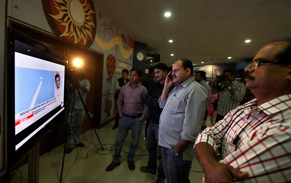 Indians watch the live telecast of the launch of Polar Satellite Launch Vehicle (PSLV-C25) rocket carrying India`s Mars spacecraft from the east-coast island of Sriharikota in New Delhi.