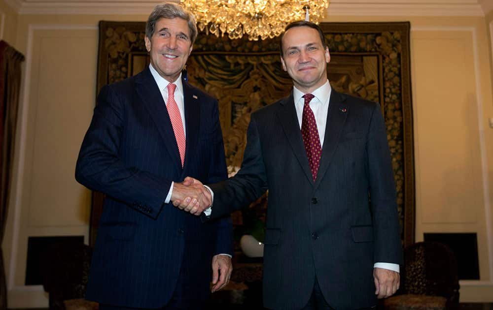 U.S. Secretary of State John Kerry, left, poses with Polish Foreign Minister Radoslaw Sikorski in Warsaw.