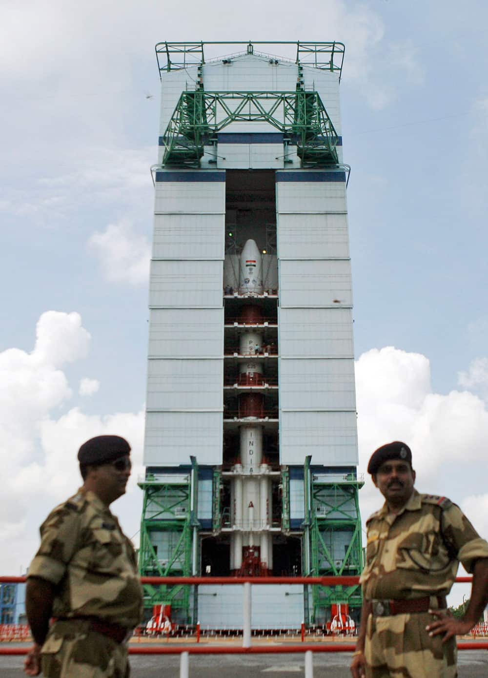 Paramilitary soldiers stand guard near the Polar Satellite Launch Vehicle (PSLV-C25) at the Satish Dhawan Space Center at Sriharikota, in the southern Indian state of Andhra Pradesh.