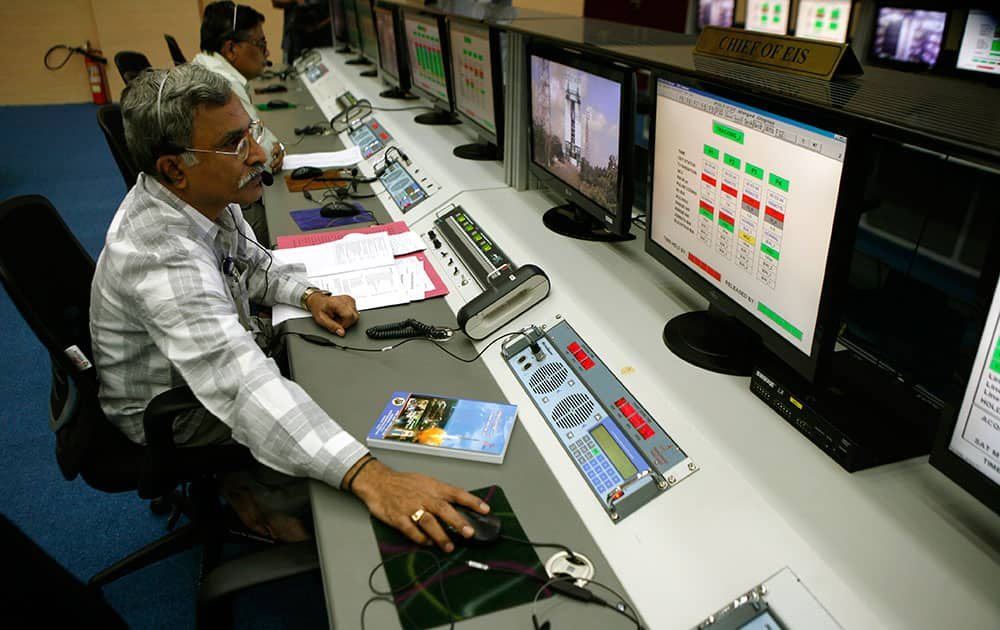 A technician monitors the functions of the Polar Satellite Launch Vehicle (PSLV-C25) at the Satish Dhawan Space Center at Sriharikota, in the southern Indian state of Andhra Pradesh.