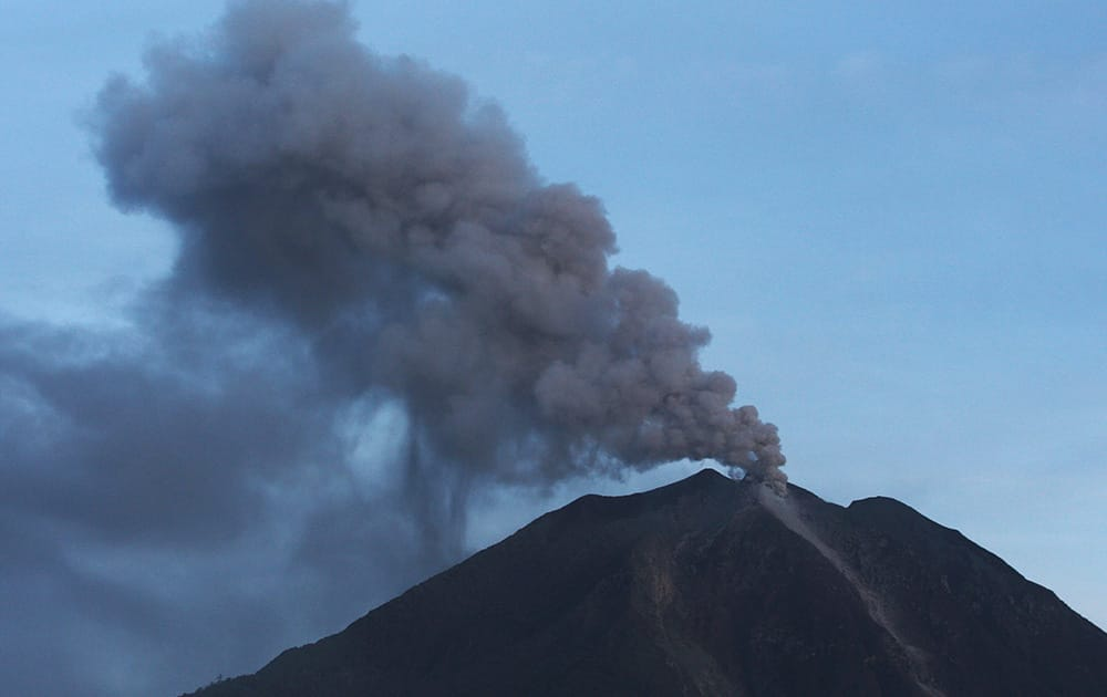 Mount Sinabung spews volcanic ash as seen from Tiga Pancur, North Sumatra, Indonesia.